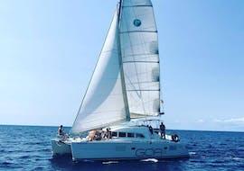 A private catamaran sails to Formentera from Ibiza with CharterAlia Ibiza.