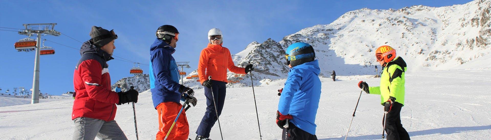 "A ski instructor is explaining the best ski techniques during a Private Ski Lessons ""Family and Friends"" Obergurgl-Hochgurgl organized by the ski school Ski- und Snowboardschule SNOWLINES Sölden in the ski resort of Sölden."