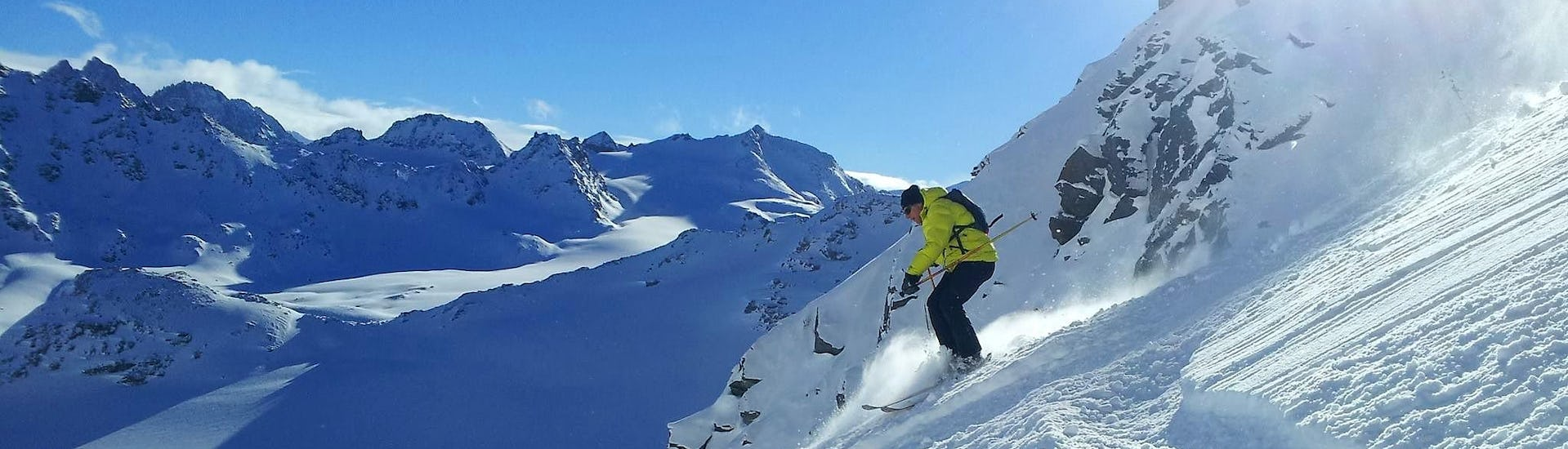 A skier is skiing down a slope with confidence during his Private Ski Lessons for Adults - All Levels with the Swiss Ski School La Tzoumaz.
