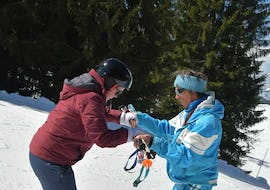 A ski instructor from the ski school ESI Easy2Ride Morzine is helping a skier to find their balance on the skis during their Private Ski Lessons for Adults - High Season - All Levels.