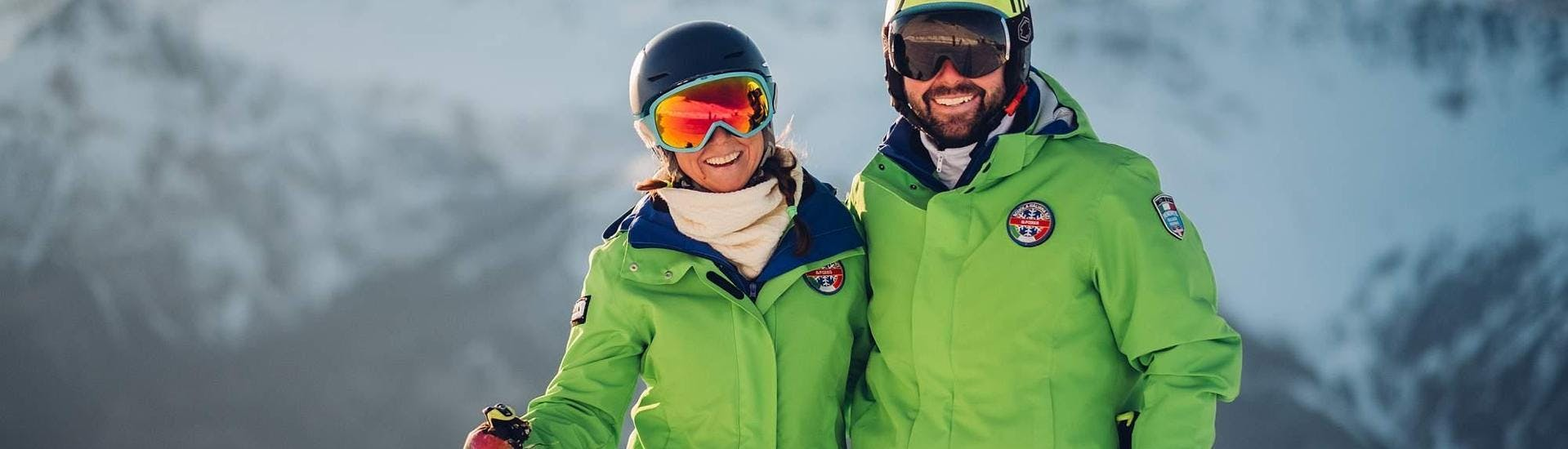 A happy skier with an ski instructor from the ski school Scuola di Sci B.foxes during the Private Ski Lessons for Adults - All Levels - Holidays.