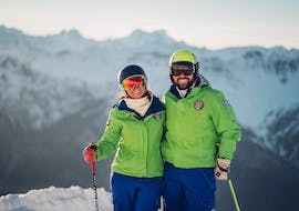 Two skiers benefit from the tailored-made Private Ski Lessons for Adults - All Levels - Holidays and the full attention of a ski instructor from the ski school Scuola di Sci B.foxes.