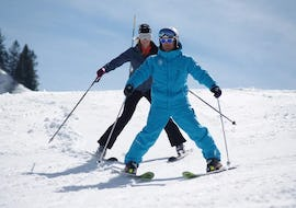 A skier and their ski instructor from the ski school ESI Easy2Ride Morzine are skiing down a slope on snowplough position during their Private Ski Lessons for Adults - All Levels - Low Season.