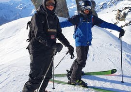 A skier and his instructor from the Ski Cool Val Thorens ski school are standing at the top of a slope, for their Private Ski Lessons for Adults for All Levels - Morning.