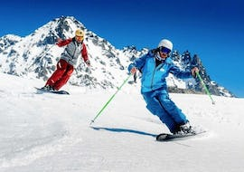 A skier is following his instructor from the ski school Ski Cool Val Thorens during Private Ski Lessons for Adults - All Levels - Low Season.
