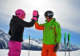 The Private Ski Lessons for Adults - All Levels are just finished, the student and the ski instructor of the Ski School Scuola di Sci Aevolution Folgarida are high-fiving.