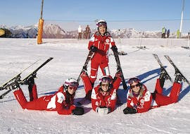 A group of ski instructors from the ski school Scuola Nazionale Sci e Snow Monte Pora is getting ready to teach Private Ski Lessons for Adults - All Levels.