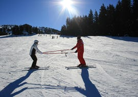 A beginner skier is practicing some basic techniques with their ski instructor from the ski school Skischule Lechner during the Private Ski Lessons for Adults - All Levels.