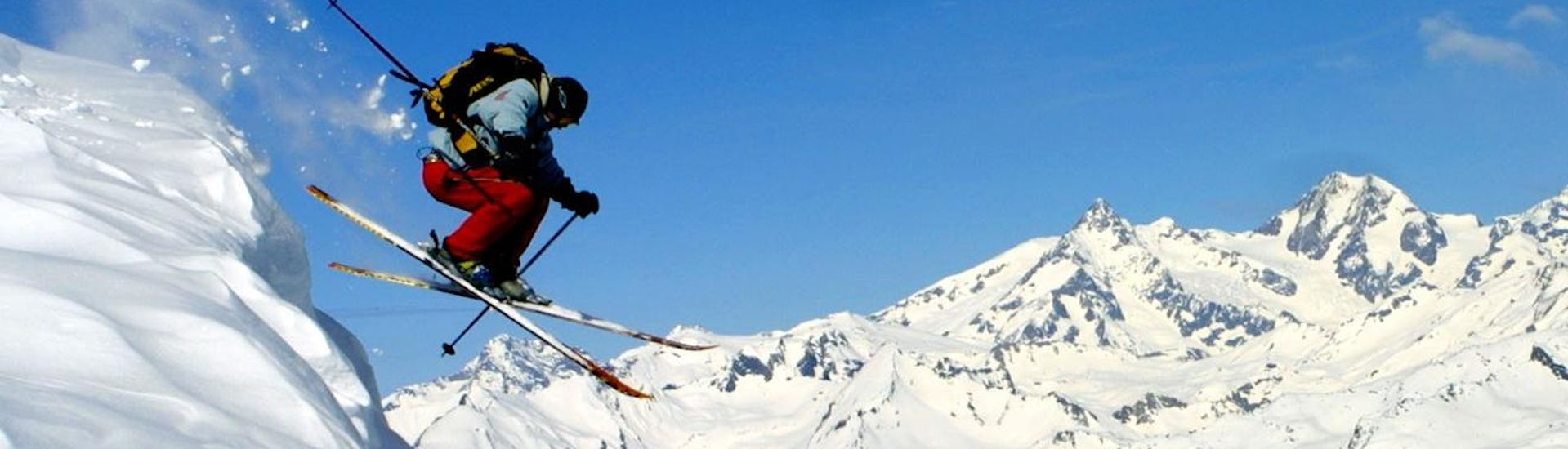 A skier is jumping during the Private Ski Lessons for Adults - All Levels from the ski school Snocool.