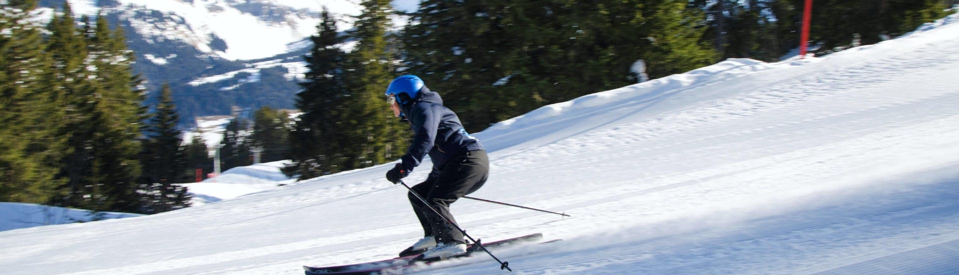 A skier is sliding down the slope during the Private Ski Lessons for Adults of All Levels with the ski school Diablerets Pure Trace.