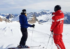 A skier is contemplating the ski area where their Private Ski Lessons for Adults of All Levels is going to take place with the ski school ESS Château d'Oex.