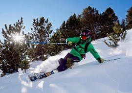 A skier is skiing down a slope with confidence during their Private Ski Lessons for Adults - Low Season with the ski school Moonshot La Bresse.