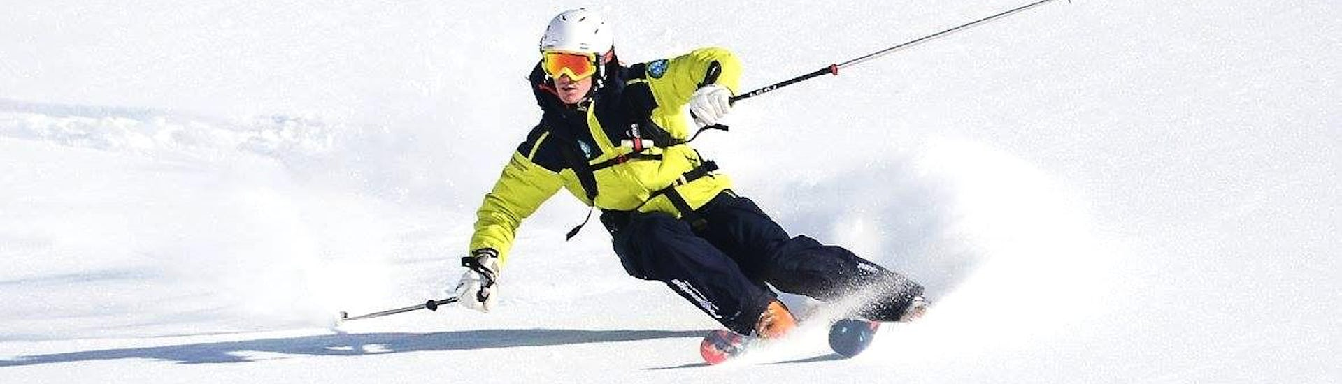 A skier is skiing down a snowy slope during hisPrivate Ski Lessons for Adults - Low Season with the ski school Prosneige Méribel.