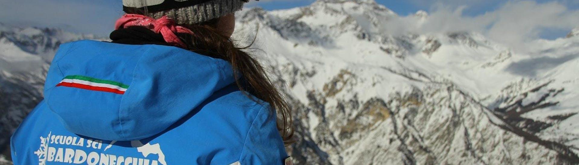 A ski instructor from the ski school Scuola di Sci Bardonecchia supervises the progress of his student during the Private Ski Lessons for Adults - Low Season.