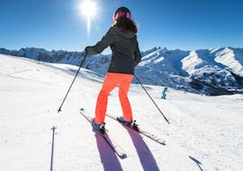 A skier is sliding down the slope during their Private Ski Lessons for Adults of All Levels - Morning with the ski school ESI Ski Family in Risoul.