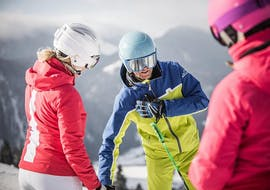 During the private ski lesson for adults in the SalzburgerLand region, two women learn how to ski with their private ski instructor from deinskicoach.at.