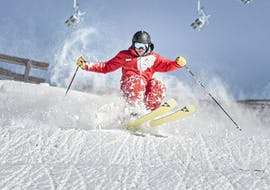 A ski instructor of Skischule Schruns is demonstrating his skills on the slopes during the Private Ski Lessons for Adults of All Levels.