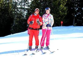 A ski course participant looks forward to great learning progress thanks to the support of a ski instructor from the Ski School St.Gallenkirch during the Private Ski Lessons for Adults of All Levels.