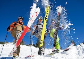 Three young skiers are enjoying their time on the slopes during Private Ski Lessons for Adults - School Holidays - All Levels with the ski school Ski Cool Val Thorens.