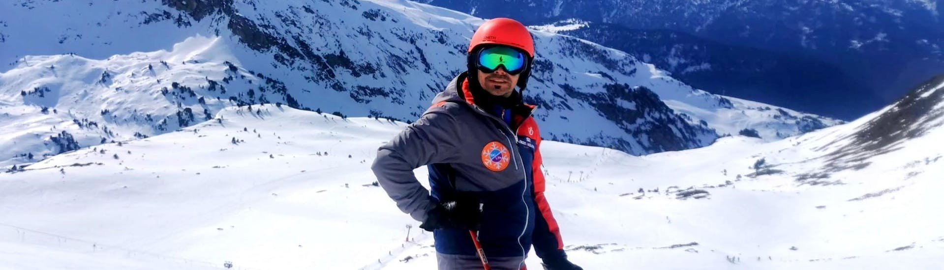 A man enjoys the beautiful views of the mountains during the Private Ski Lessons for Families of All Levels of Ski Life Escuela de Esqui Baqueira.