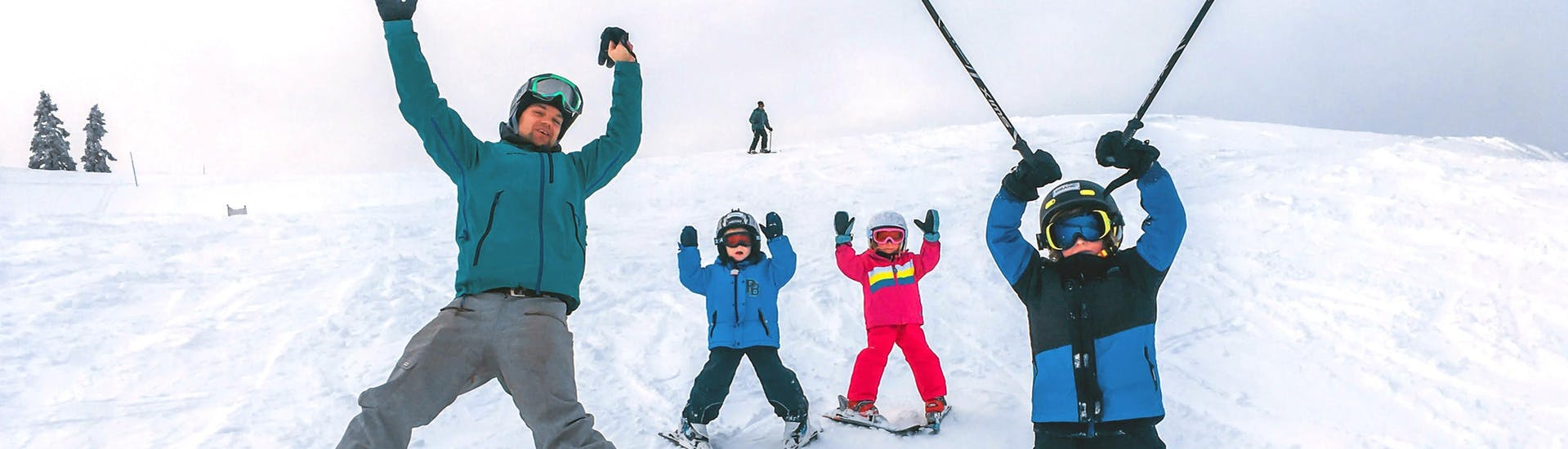 Three siblings are enjoying their Private Ski Lessons for Kids (3-14 y.) of All Levels with their instructor from Funpark Menina.