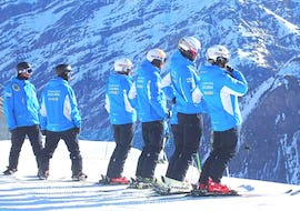 A group of skiers is preparing for the Private Ski Lessons for Kids & Adults - February of the ski school Scuola di Sci Azzurra Livigno.