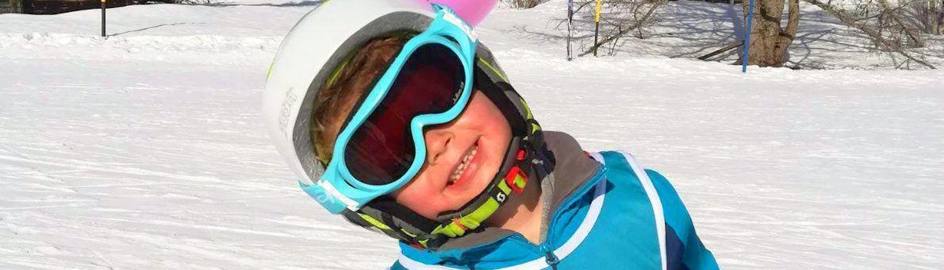 Child smiles into the camera during his Private Ski Lessons for Kids - All Ages with the ski school Diablerets Pure Trace.