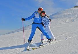 A child has fun during the Private Ski Lessons for Kids for All Ages of the ski and snowboard school Scuola di Sci e Snowboard Prato Nevoso.