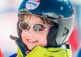 A child is having lots of fun during the Private Ski Lessons for Kids - All Levels designed by a ski instructor from the ski school ESF Ski School Val d'Isère.
