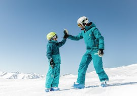 A child is enjoying the tailored-made Private Ski Lessons for Kids - All Levels and benefits from the full attention of an experienced instructor from NTC Skischule Oberstdorf.