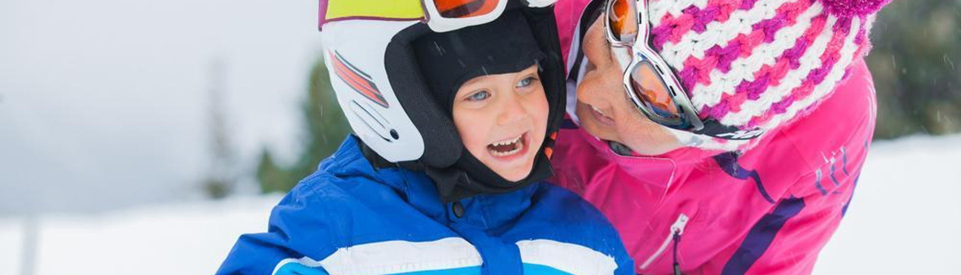 A ski instructor from Schneesportschule Morgenstern and her pupil are having fun during Private Ski Lessons for Kids - All Levels.
