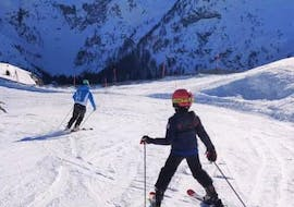A young skier is learning how to master the slopes during the Private Ski Lessons for Kids - All Levels organized by the ski school Scuola di Sci Pinzolo in the Val Rendena ski resort.