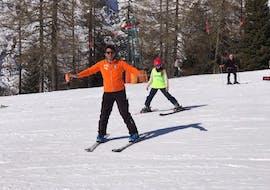 Private Ski Lessons for Kids - All Levels of the Italian Ski School School Scuola Italiana di Sci Civetta are helping this child to improve.