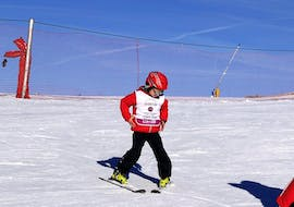 A young boy is learning to ski during Private Ski Lessons for Kids - All Levels with the ski school Scuola Nazionale Sci e Snow Monte Pora.