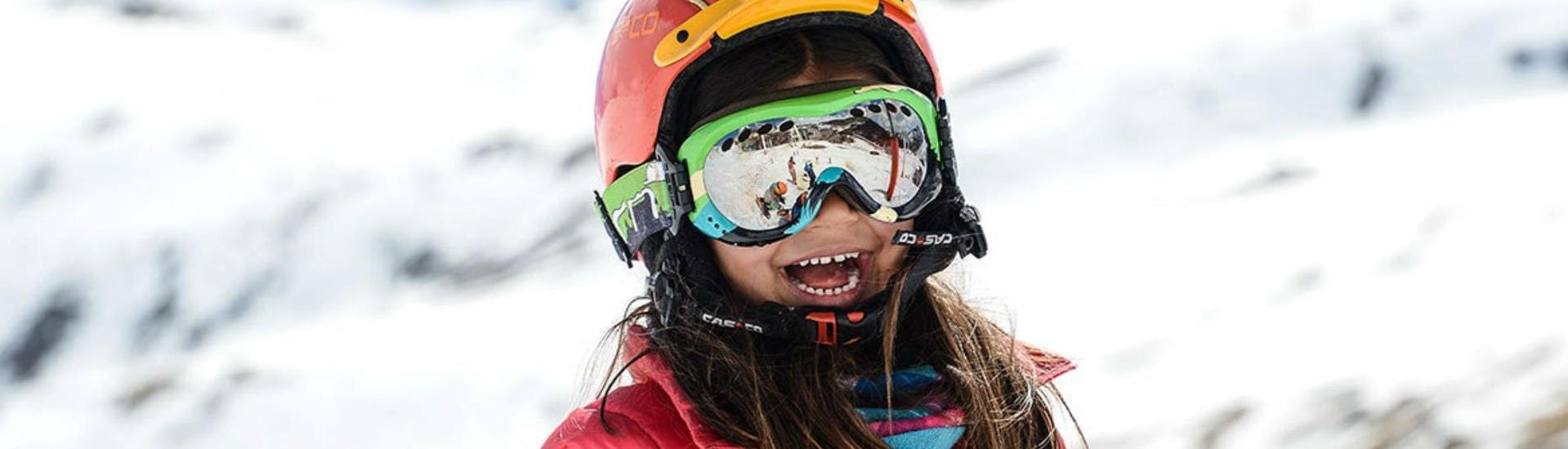 A young girl is laughing and seemingly enjoying herself during her Private Ski Lessons for Kids - High Season with the ski school Prosneige Méribel.