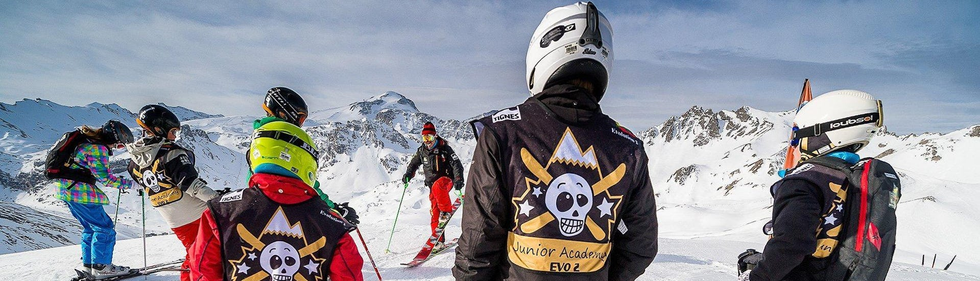 A young skier is listening to the instructions of his ski instructor from the ski school Evolution 2 Tignes before his Private Ski Lessons for Kids - Holiday - Afternoon.