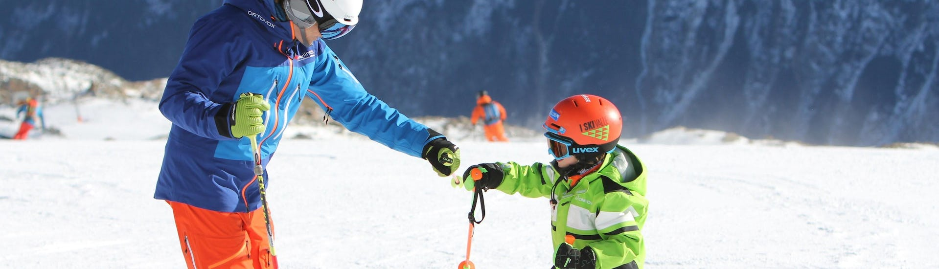 A young skier is having fun with a private ski instructor from the ski school during a Private Ski Lessons for Kids in Obergurgl-Hochgurgl organized by the ski school Ski- und Snowboardschule SNOWLINES Sölden in the ski resort of Sölden.