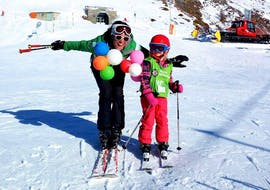 The ski instructor has fun in the snow with her student during the Private Ski Lessons for Kids of All Ages from Alpine Ski School Zermatt.