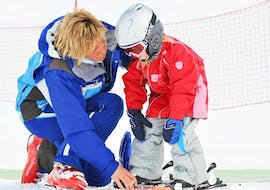 During the Private Ski Lessons for Kids of All Ages, an experienced ski instructor from Schischule Hochgurgl is teaching a young girl how to ski.