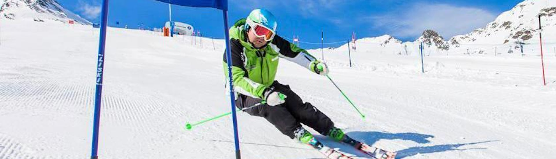 "A skier is mastering the slopes in the ski area of Ötztal in Sölden during the Private Ski Lessons ""Race Training"" for Adults - All Levels organized by the ski school Ski- and Bike School Ötztal Sölden."