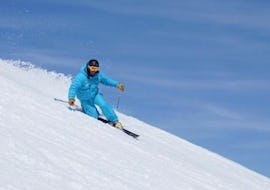 A Private Ski Touring Guide - All Levels from the ski school ESI Font Romeu is skiing down a snowy slope.