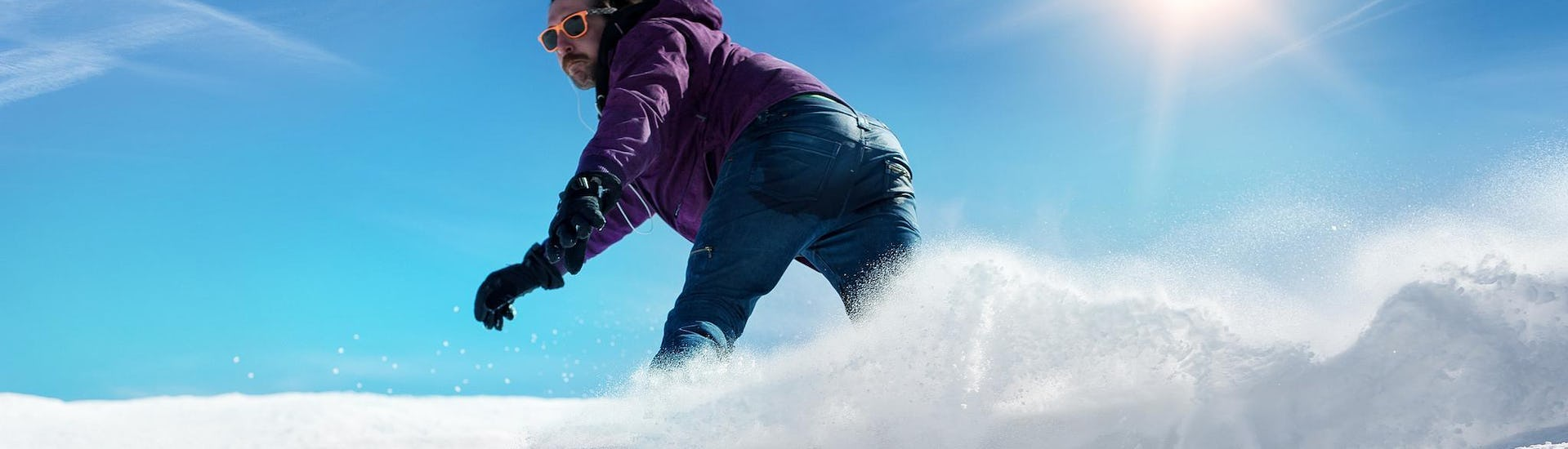 A snowboarder is sliding down a snowy slope during hisPrivate Snowboarding Lessons for Kids & Adults - Low Season with the ski school ESI Easy2Ride Morzine.