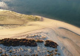Deserted beach where you will eat during the Private Sunset Boat Trip in the Ria Formosa Natural Park with Odyssey Tours.