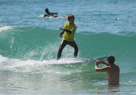 A child is having private Surfing Lessons in low season on the Plage Sud in Hossegor with the instructor of Tao Magic glisse.