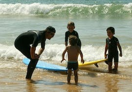 3 children have a private surfing lesson on the sail fish beach for all levels with the nomad surf school.