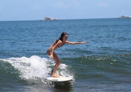 A kid is having her Private Surfing Lessons for All Levels from 8 years with It's On Surf School.