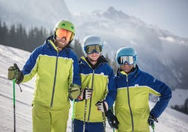 The three ski instructors from deinskicoach.at are smiling at the camera as they prepare to welcome children to their private ski lessons for kids in the SalzburgerLand region.
