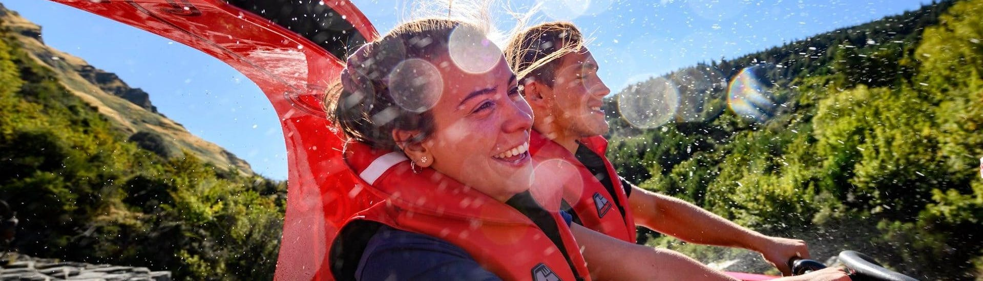 Participants of the Queenstown Jet Boat Tour to Shotover Canyon & 4x4 Experience organized by Shotover Jet Queenstown have fun on the boat.
