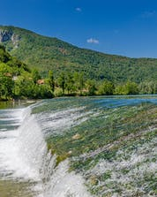 A beautiful photo of rapid waters in Croatia where you can do rafting on the Kolpa River.
