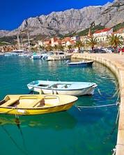 A summer landscape photo of a city-port in Croatia where you can do rafting in Makarska.